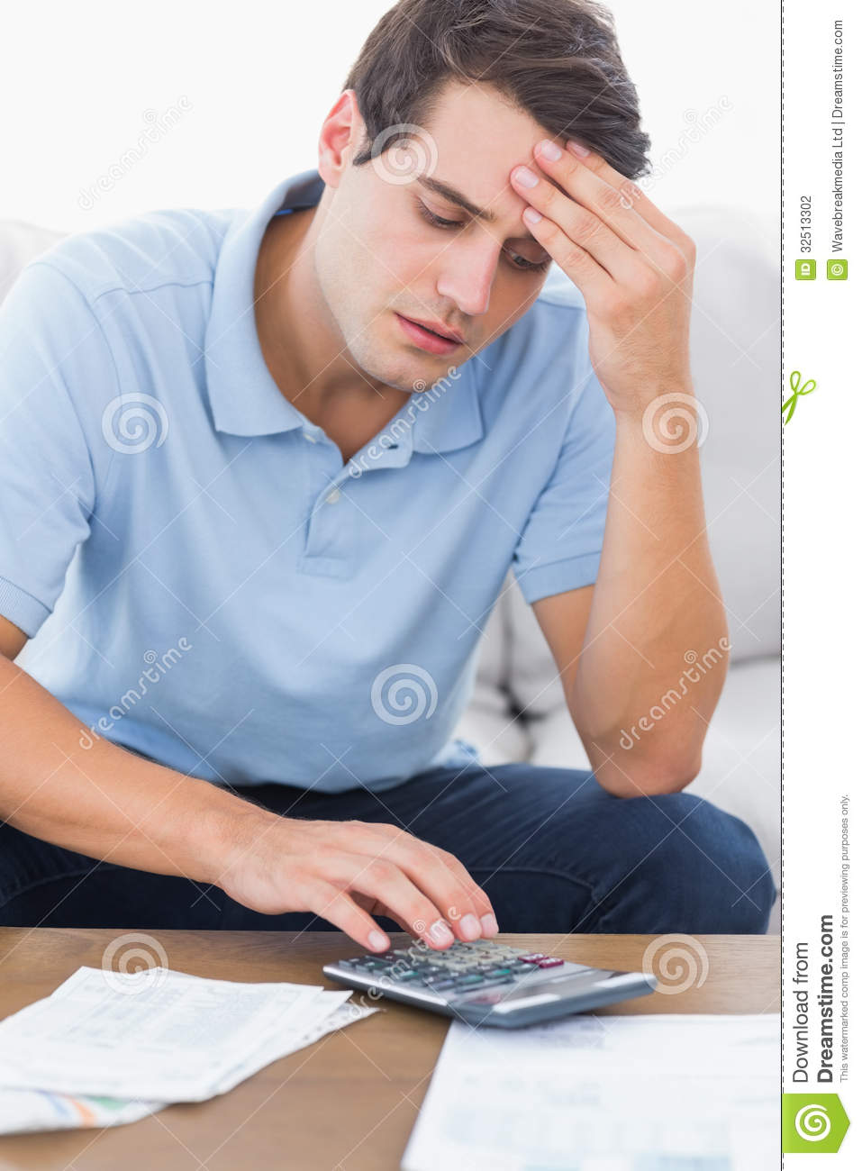 Man doing his accounts with a calculator