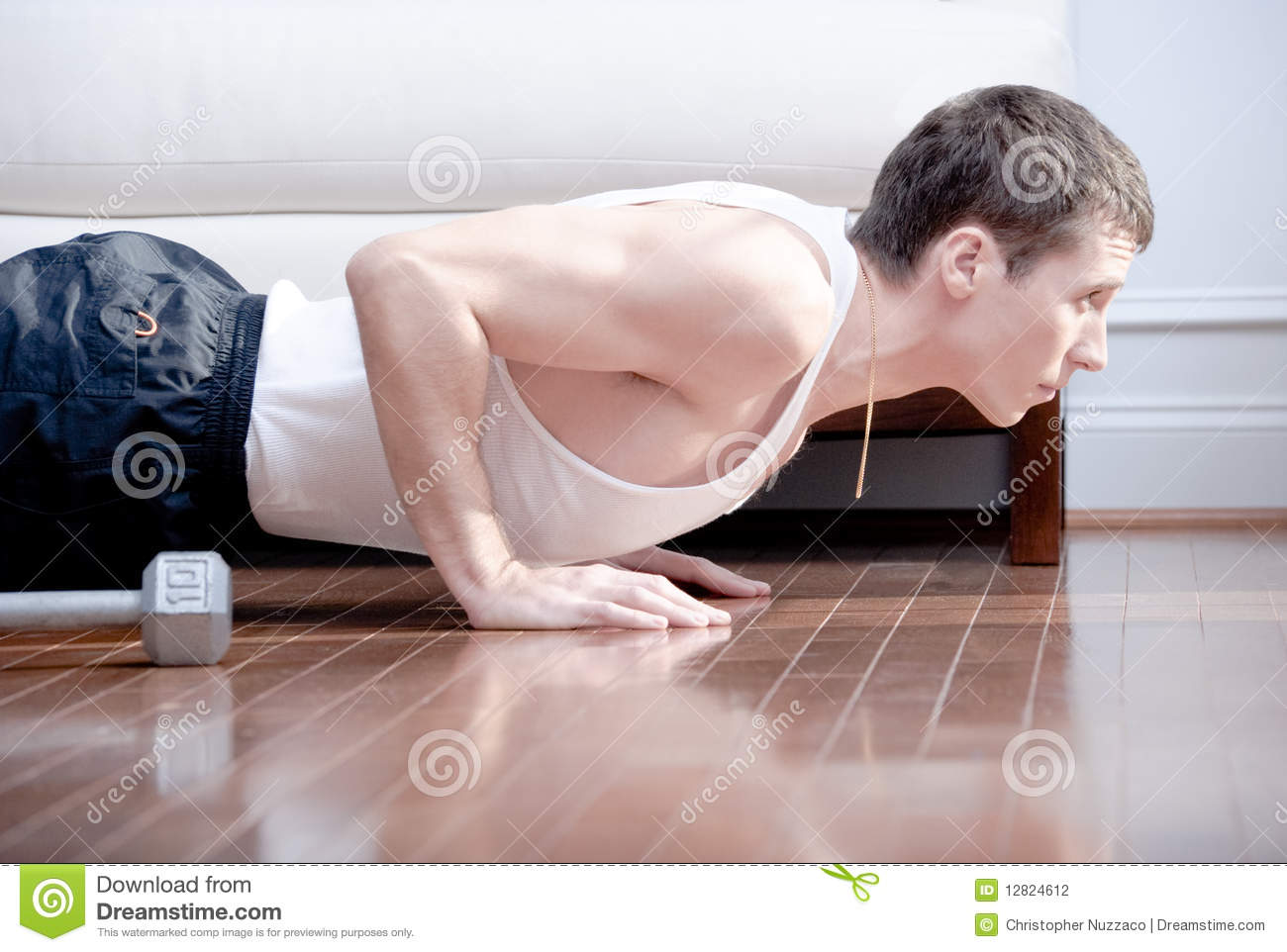 Man Doing Push Ups In Living Room Stock Photography