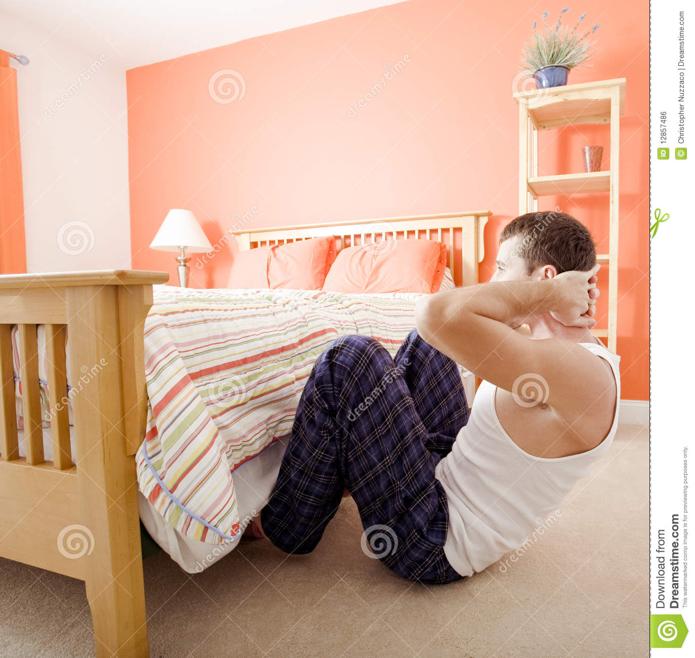 Man doing sit ups in bedroom stock photo image 12857486 for Beds that sit up