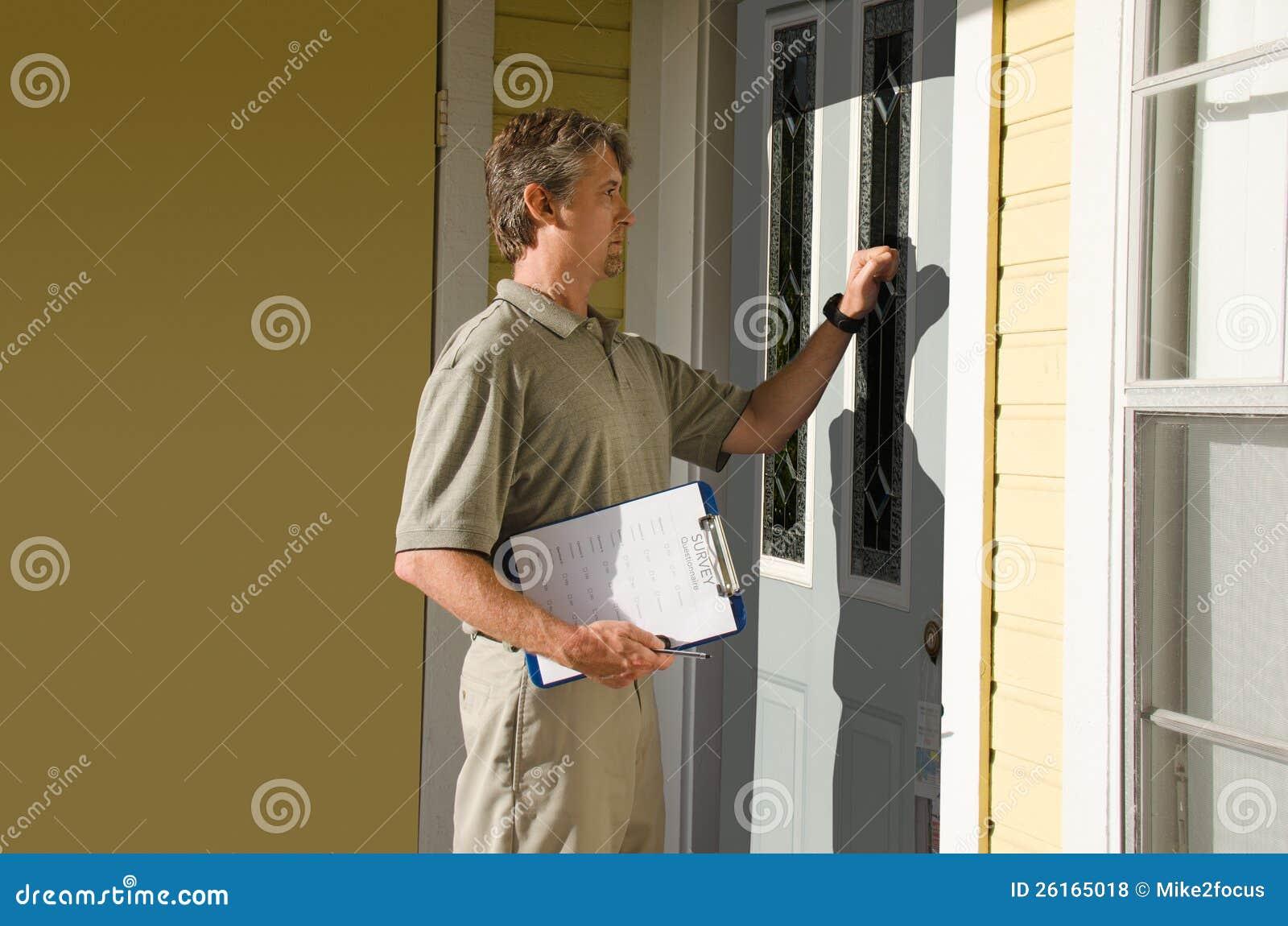 Man doing survey or petition work door-to-door