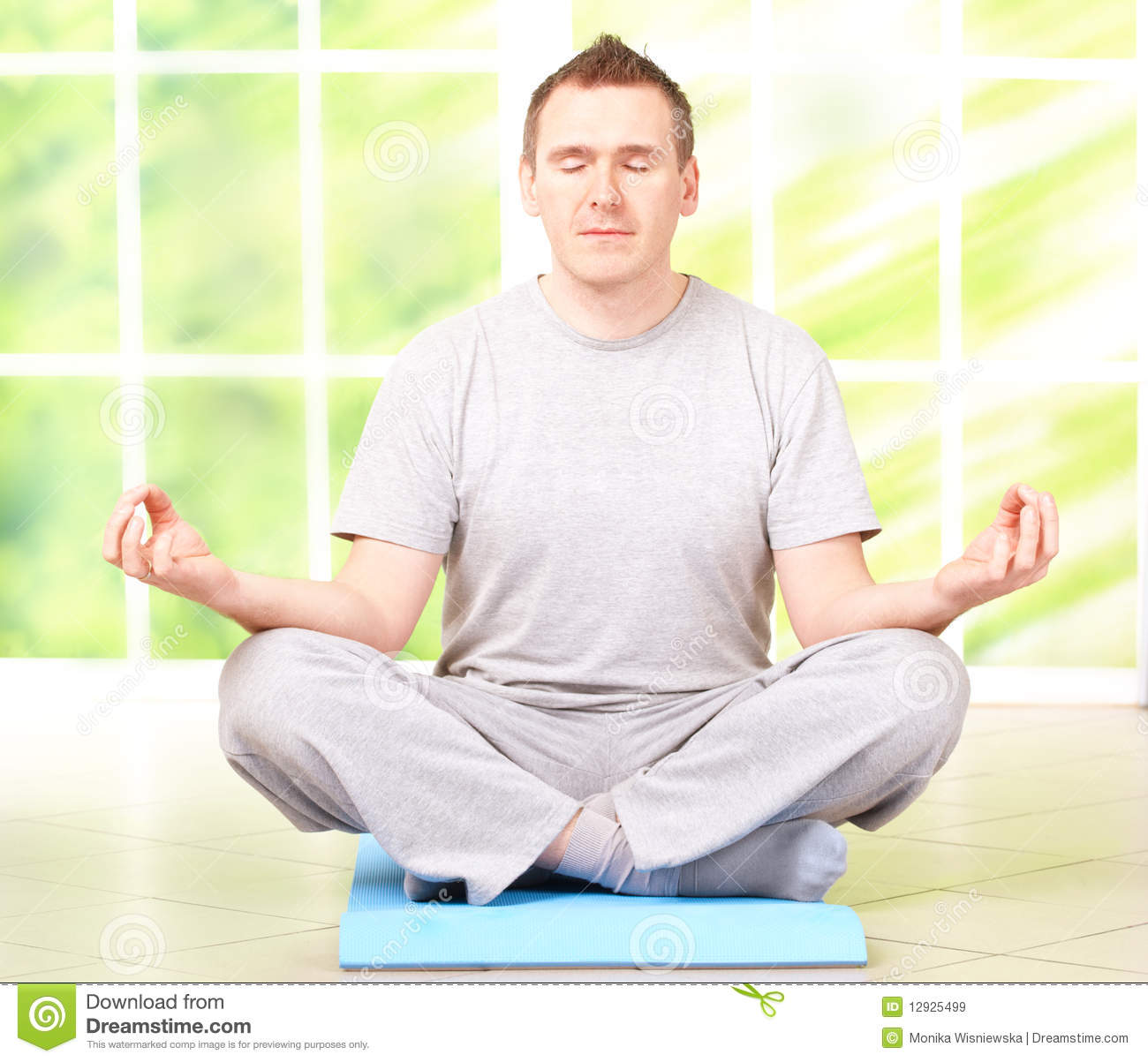 Man Doing Yoga Exercise On Mat Stock Image Image 12925499