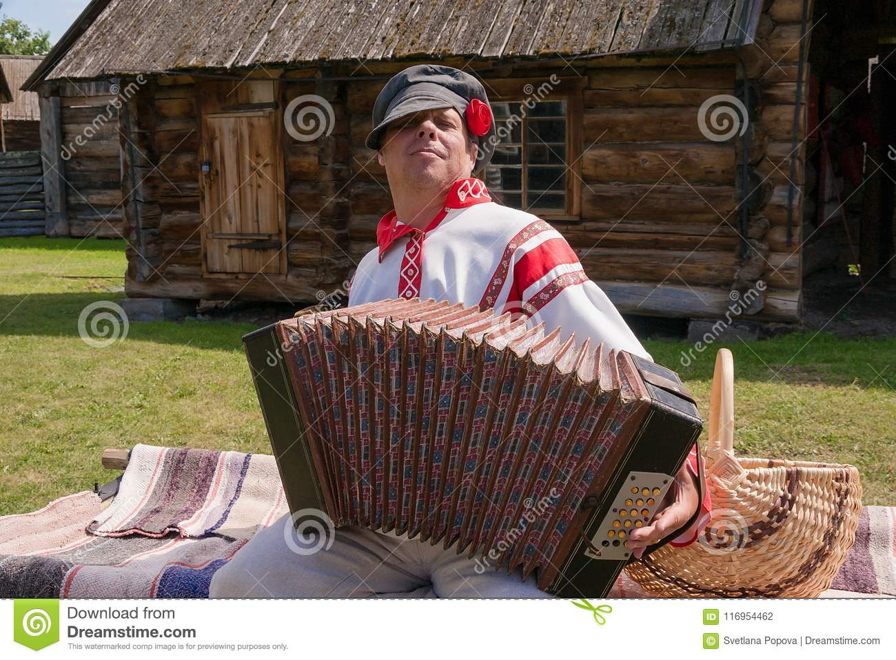 A Man, Dressed In A Russian Folk Costume, Plays The