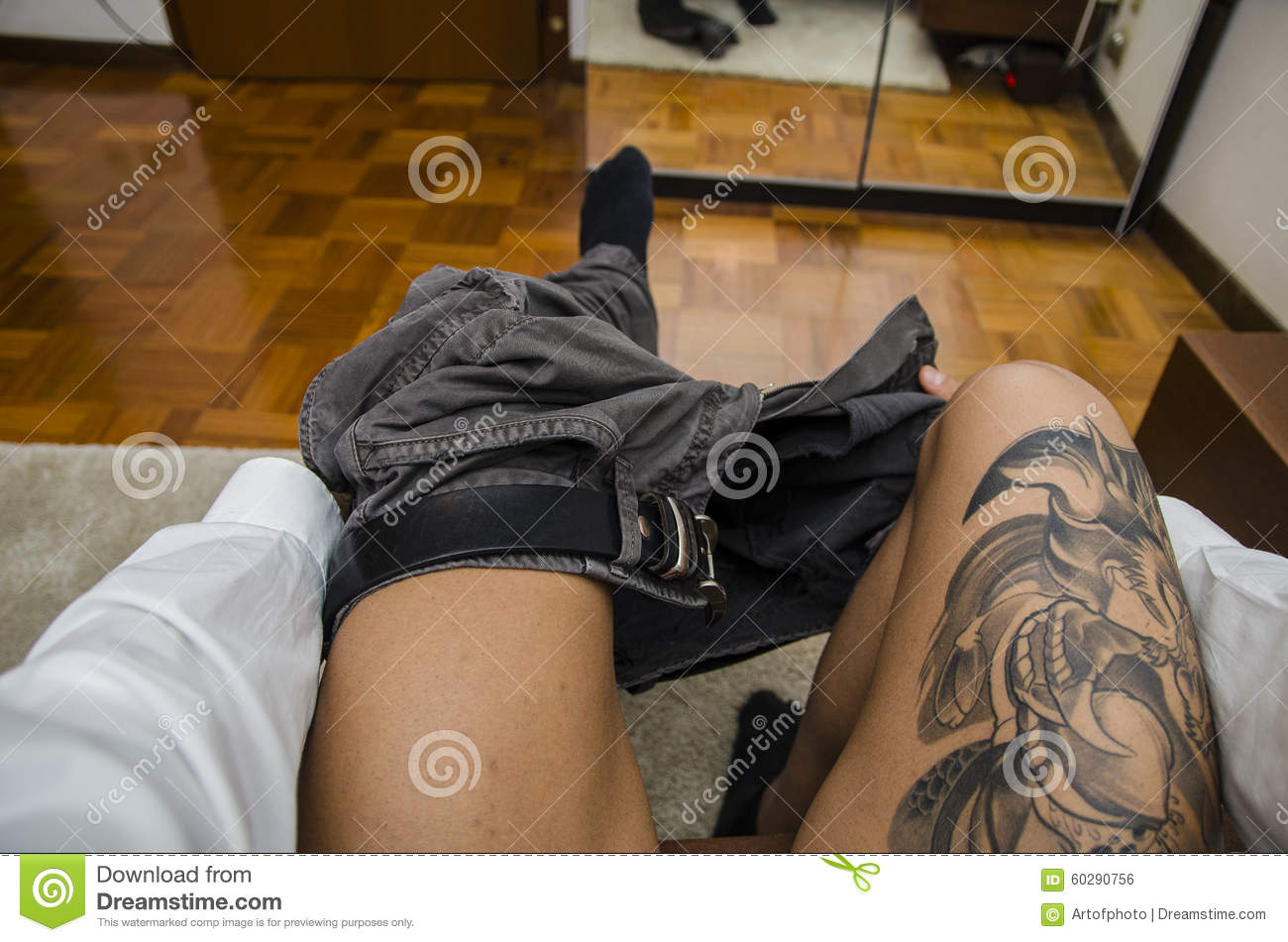 Man Dressing, Putting Pants On. Self POV Stock Photo ...