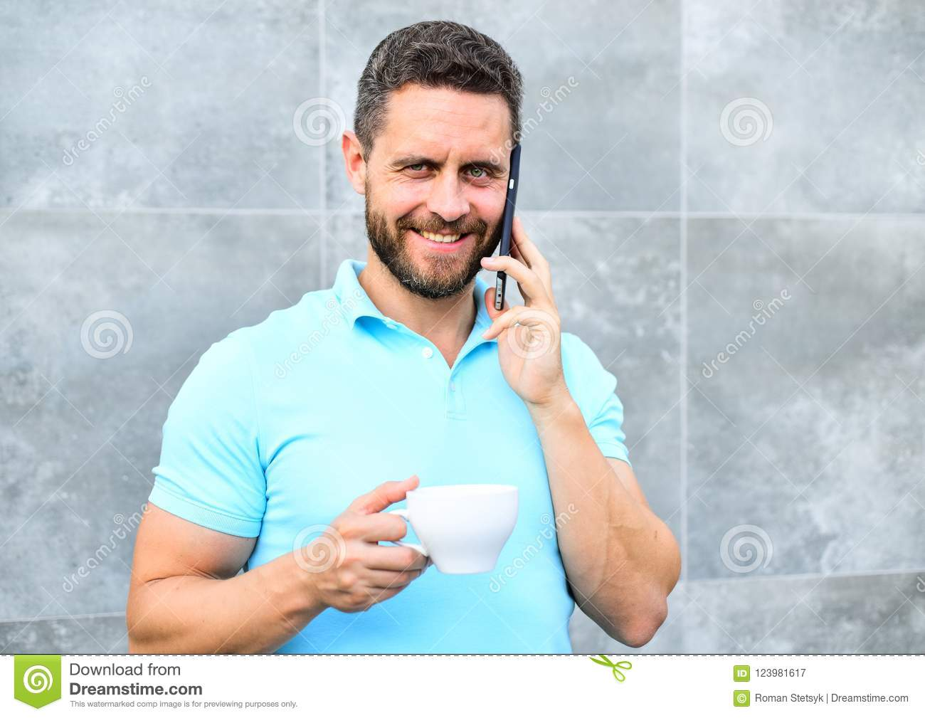 Man drink cappuccino speak phone grey wall background. Reasons entrepreneurs drink coffee. Even if you drink coffee on