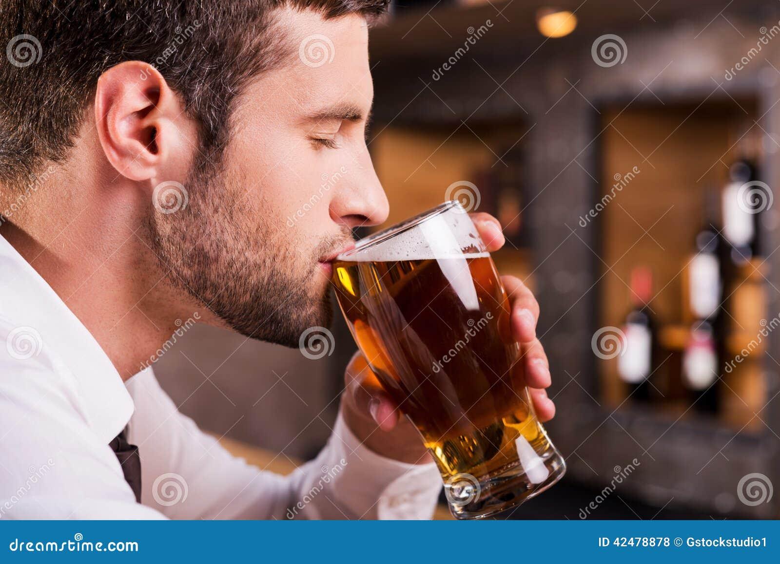 Man drinking beer.