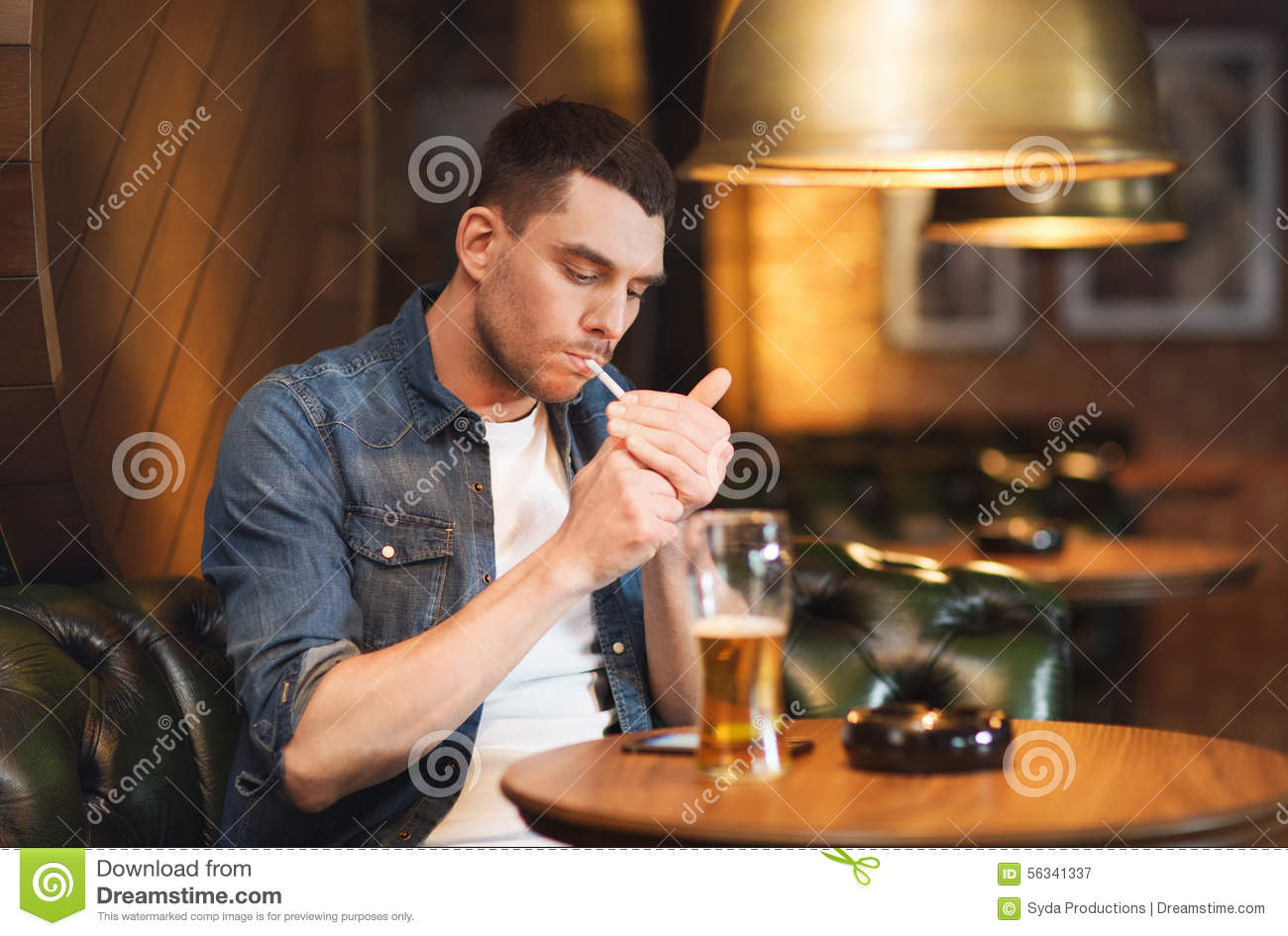 People drinking beer at bar