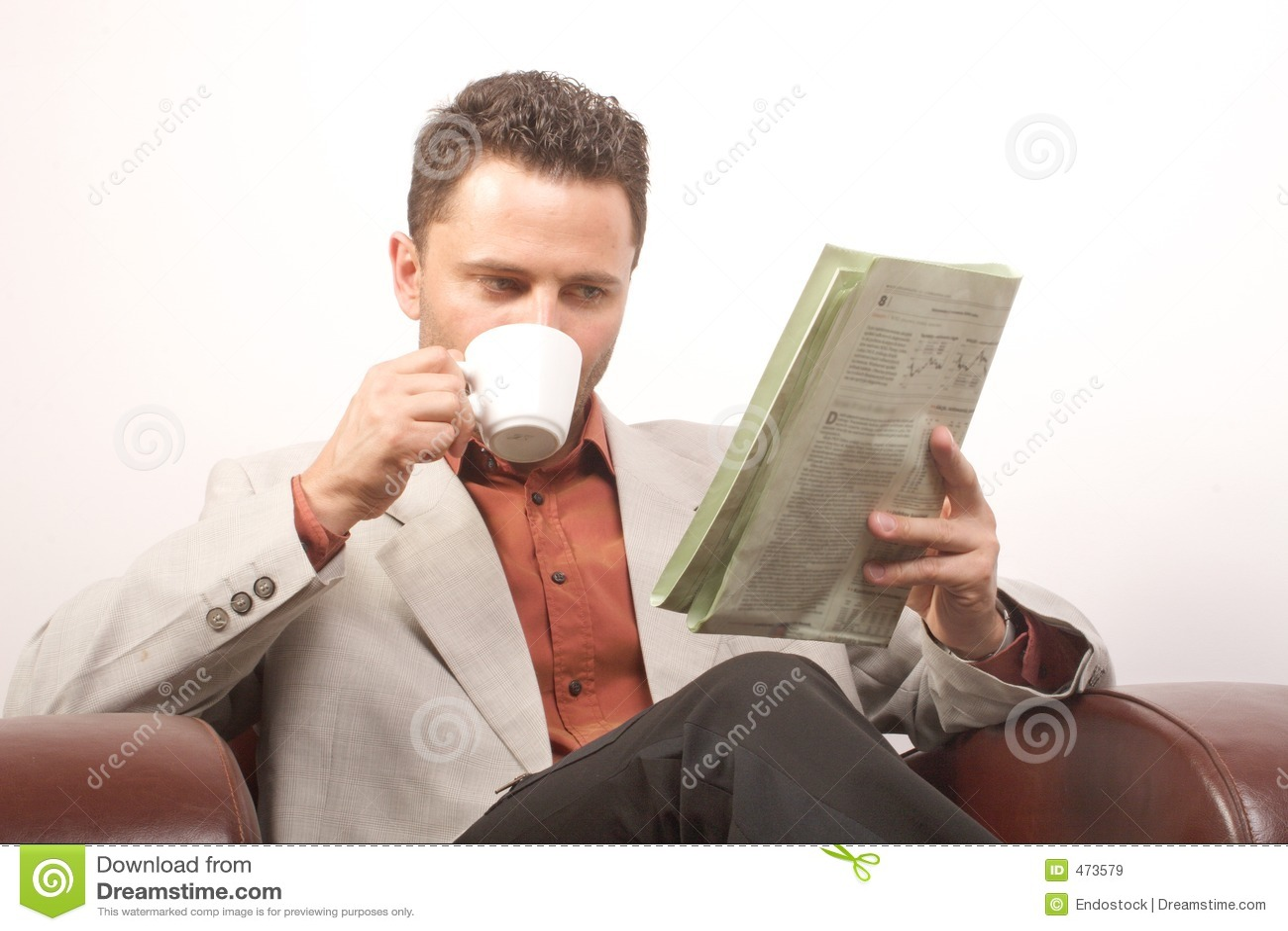 Man drinking coffee,reading newspaper
