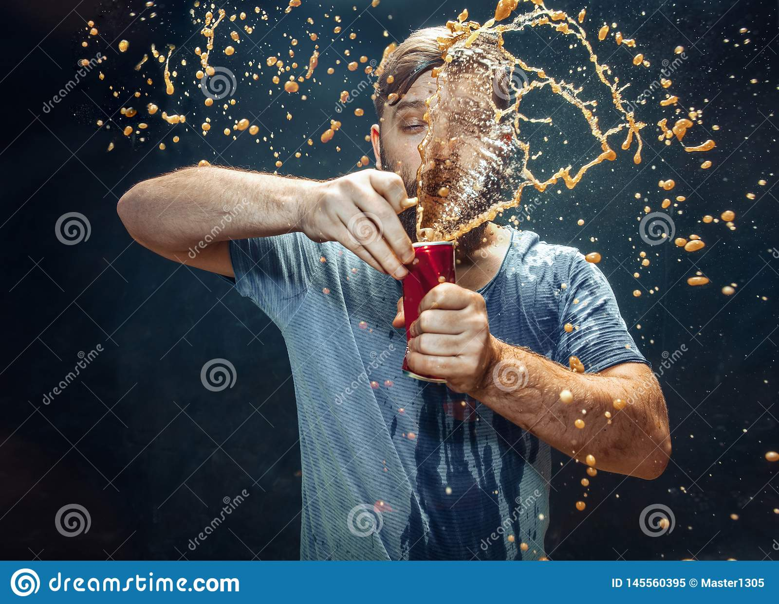 Man drinking a cola and enjoying the spray.