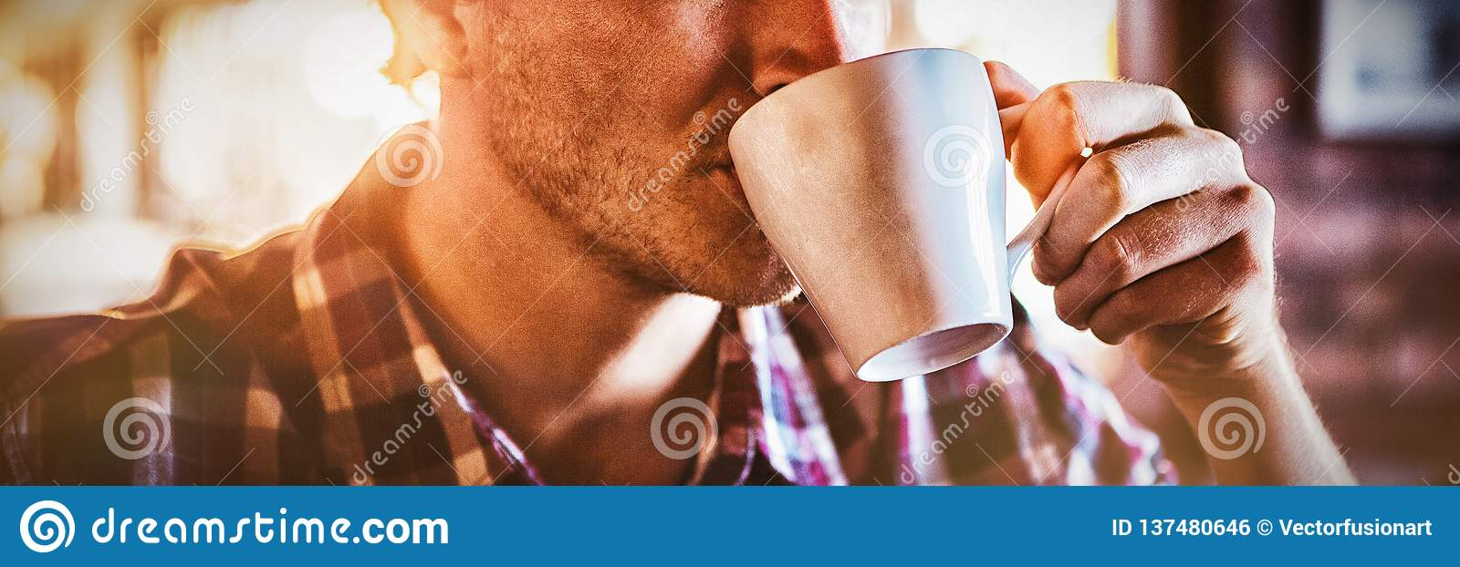 Man drinking a cup of coffee. In the cafe royalty free stock image