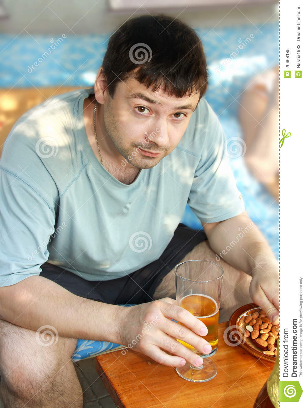 Man Drinking Lager Beer With Nuts Royalty Free Stock Photo