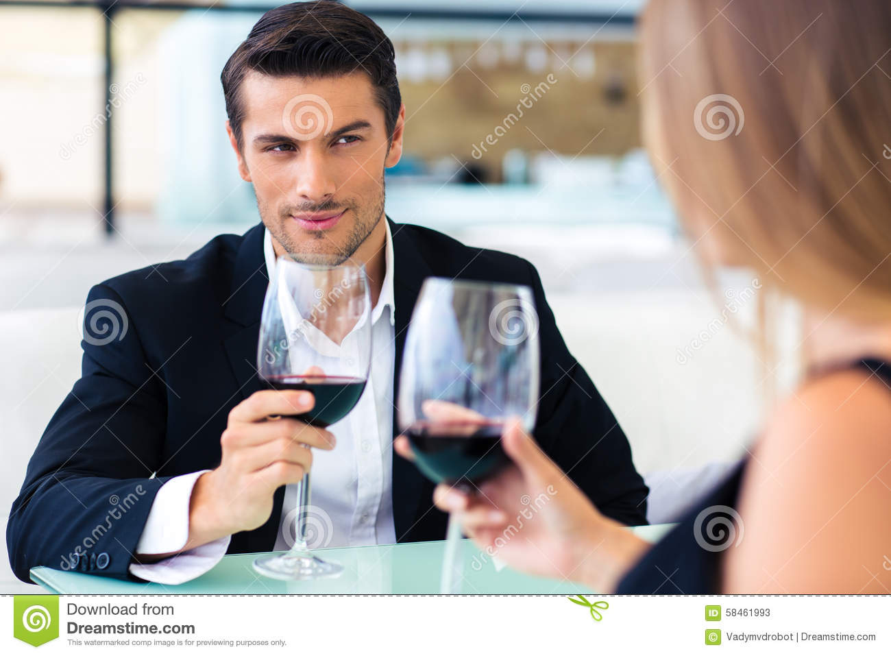 Man drinking red wine with his girlfriend