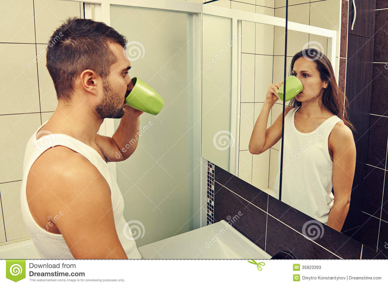 Man drinking tea and looking at a woman stock photos for Looking for mirrors