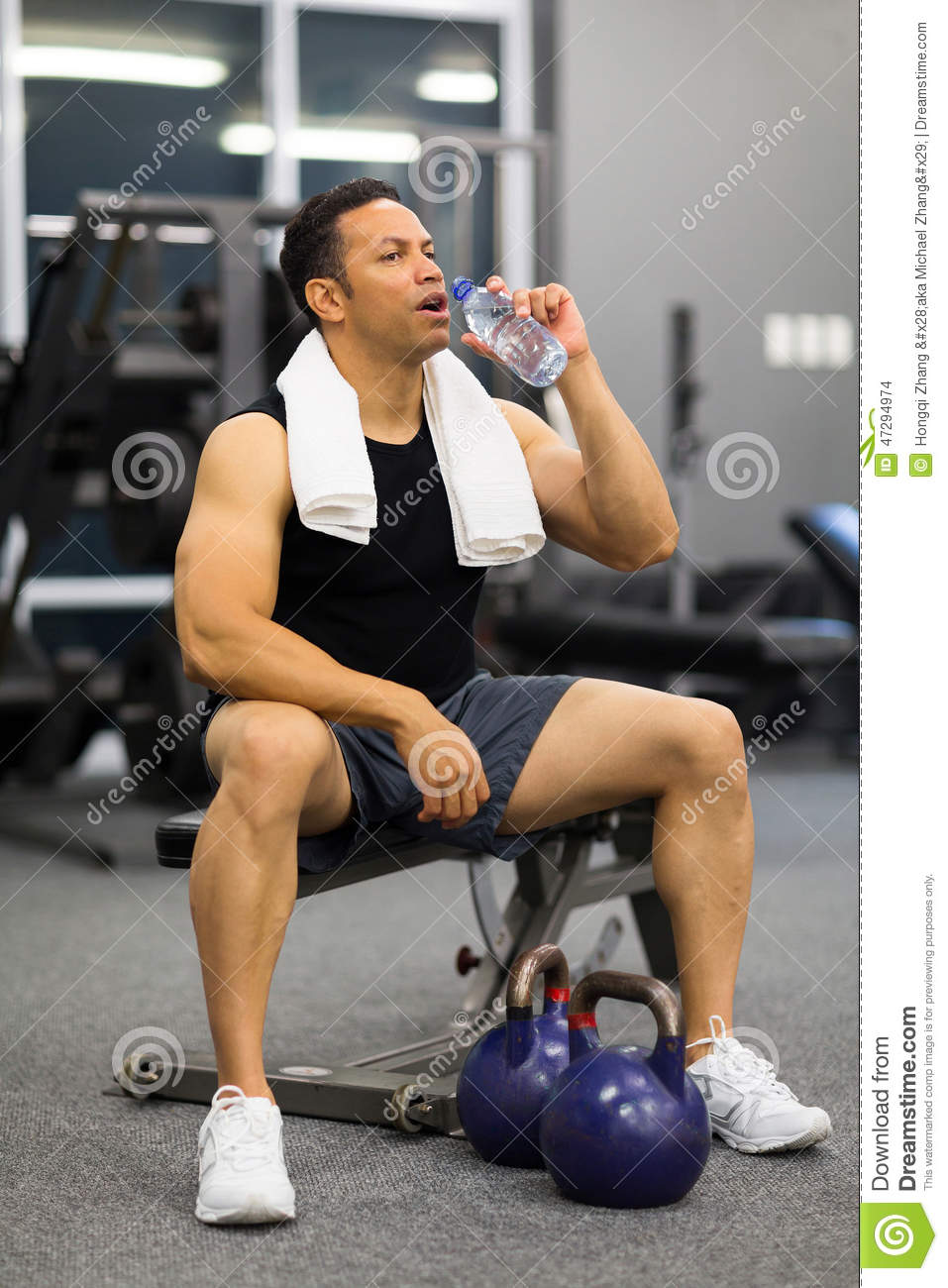Man drinking water after exercise stock photo image of handsome man drinking water after exercise sciox Choice Image