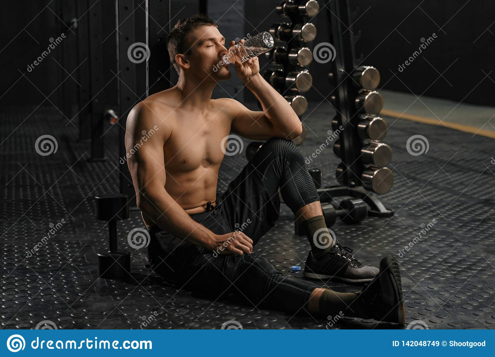 Man drinking water after hard training