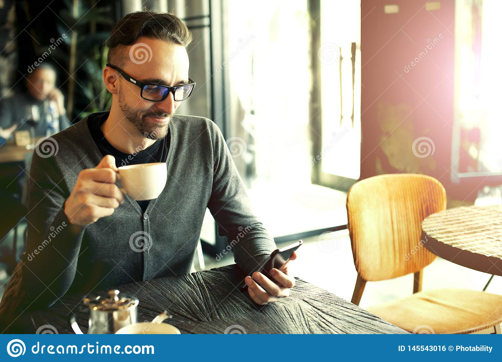 Man drinks coffee in a cafe