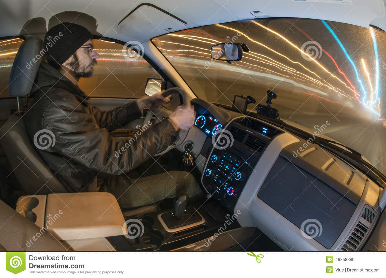 man driving car at night stock photo image 49358380
