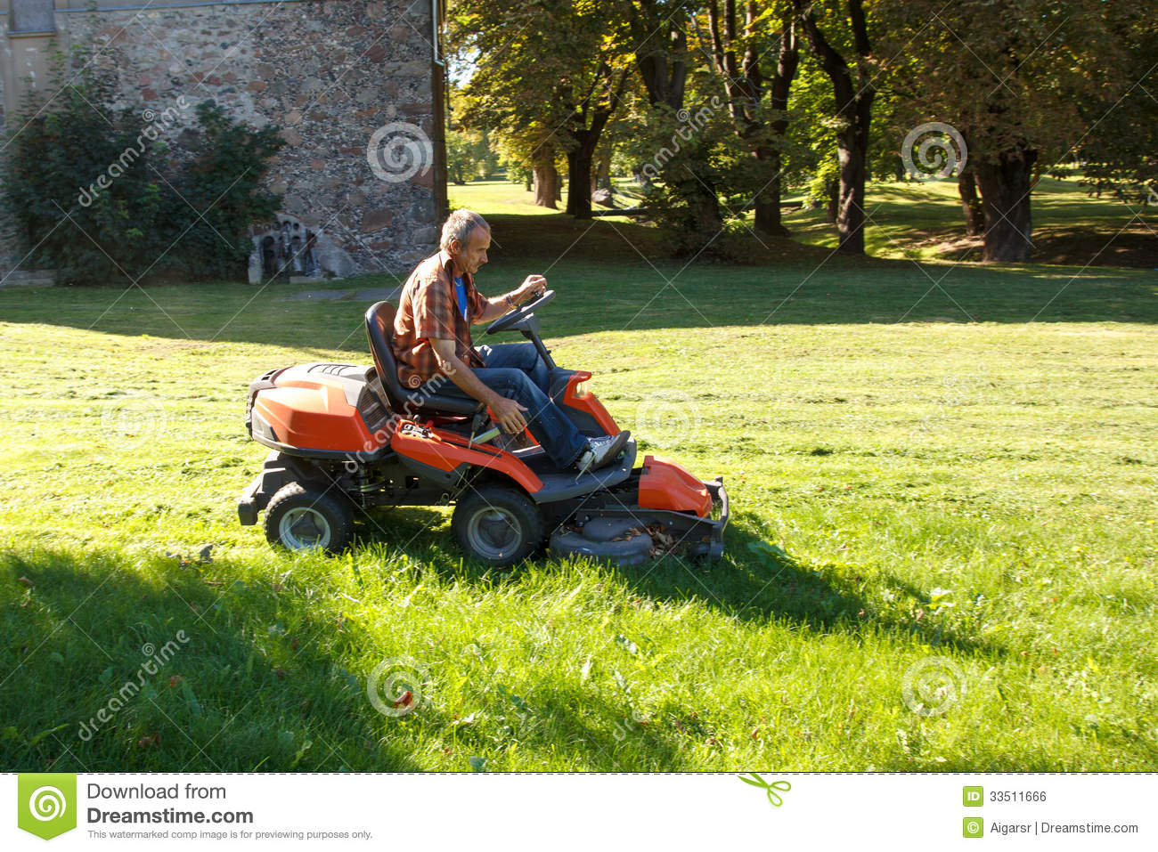 Man On Tractor Lawn Enforcment : Man driving a red lawn mower tractor royalty free stock