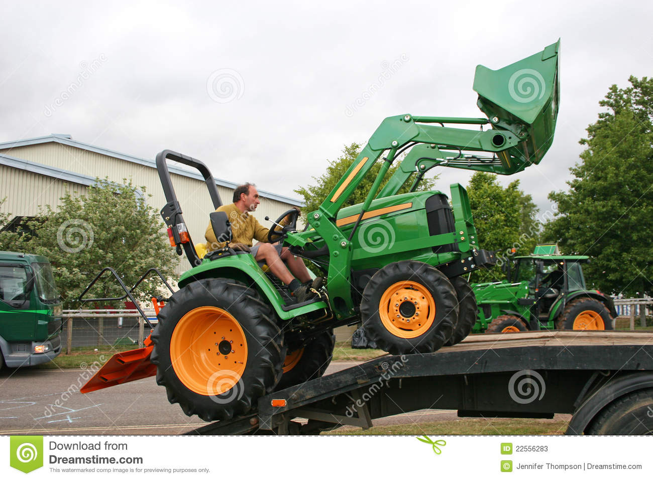 Guy On Tractor : Man driving tractor stock image of work machines