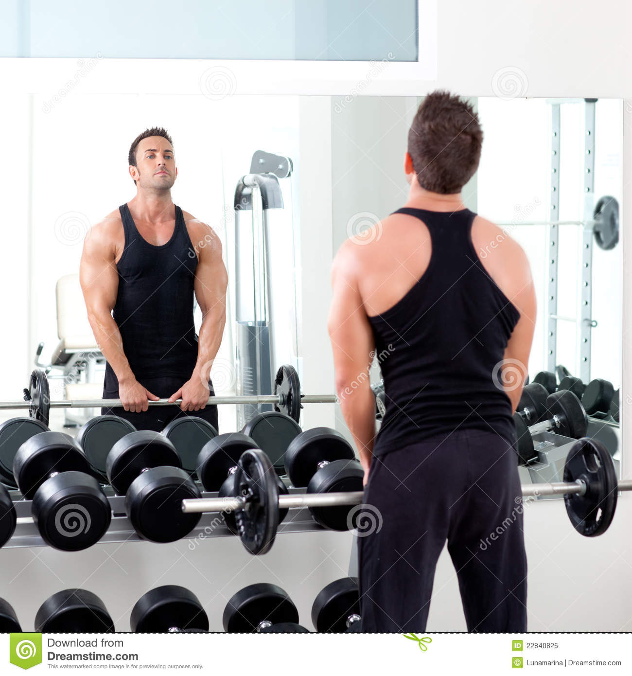 Man with dumbbell weight training equipment gym stock