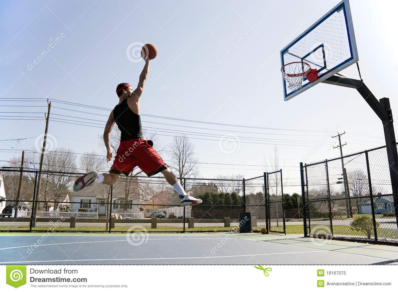 Man Dunking the Basketball stock image. Image of park ...