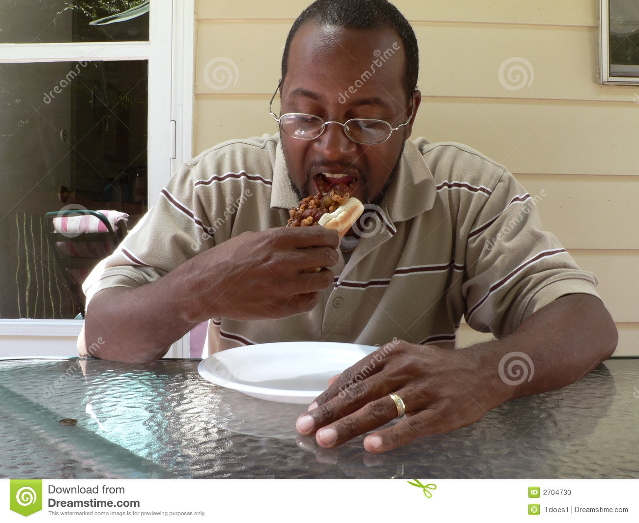 Man Eating A Chili Hotdog 2 Stock Photo - Image: 2704730