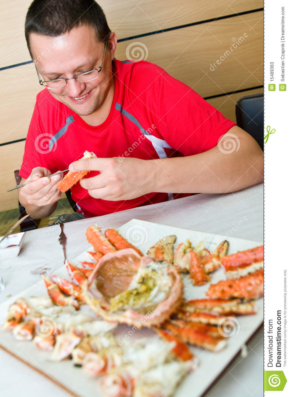 Man eating King crab s...