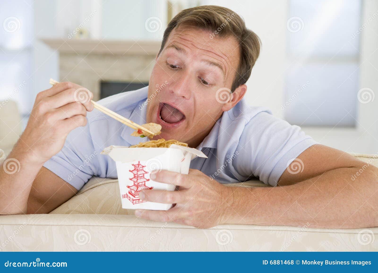 Man Eating Takeaways With Chopsticks