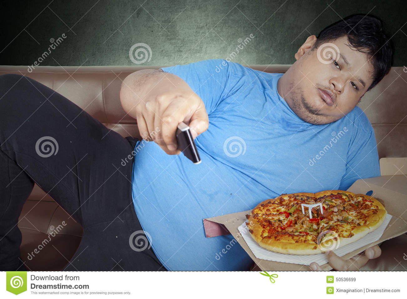 Lazy Person On Couch Man Eats Pizza While W...