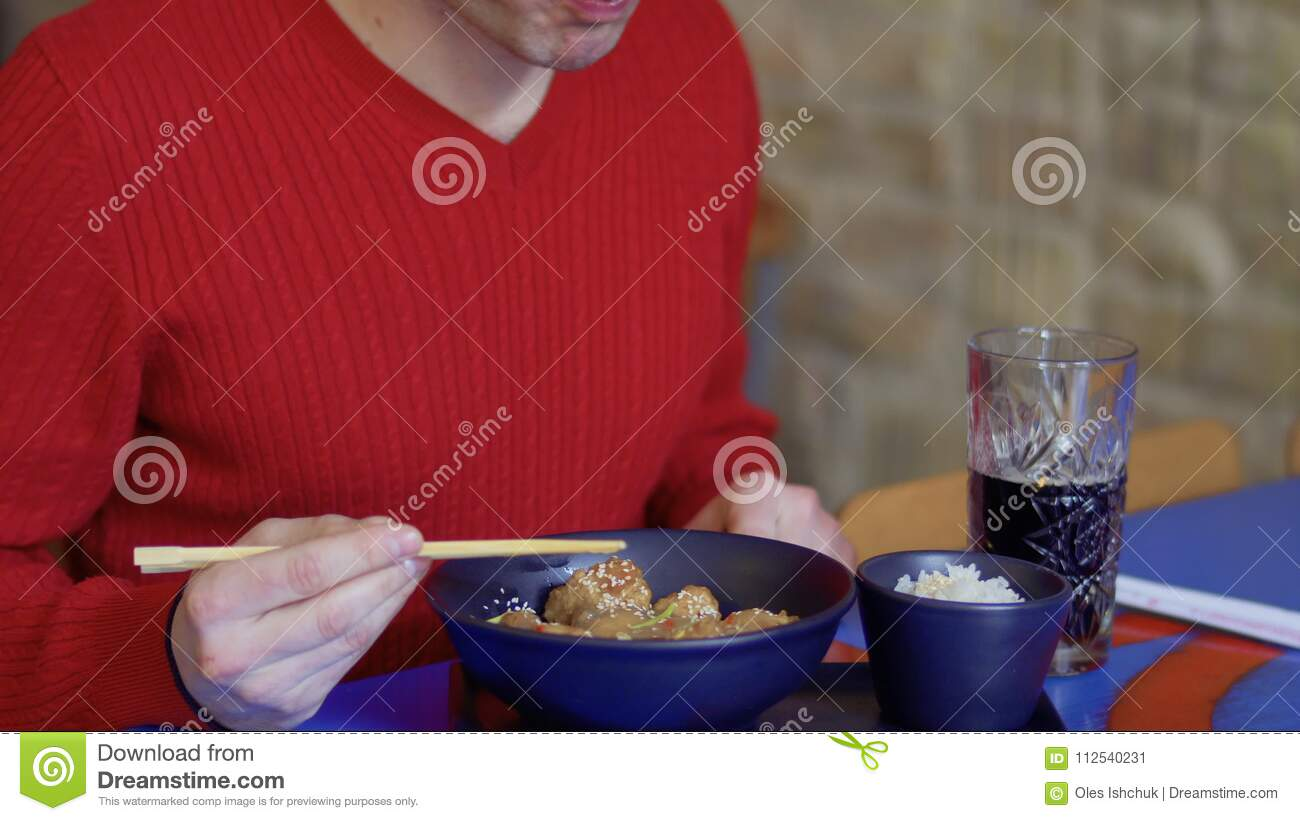 Man Eats The Tasty Chicken With Sesame And Drinks Cola In The Korean