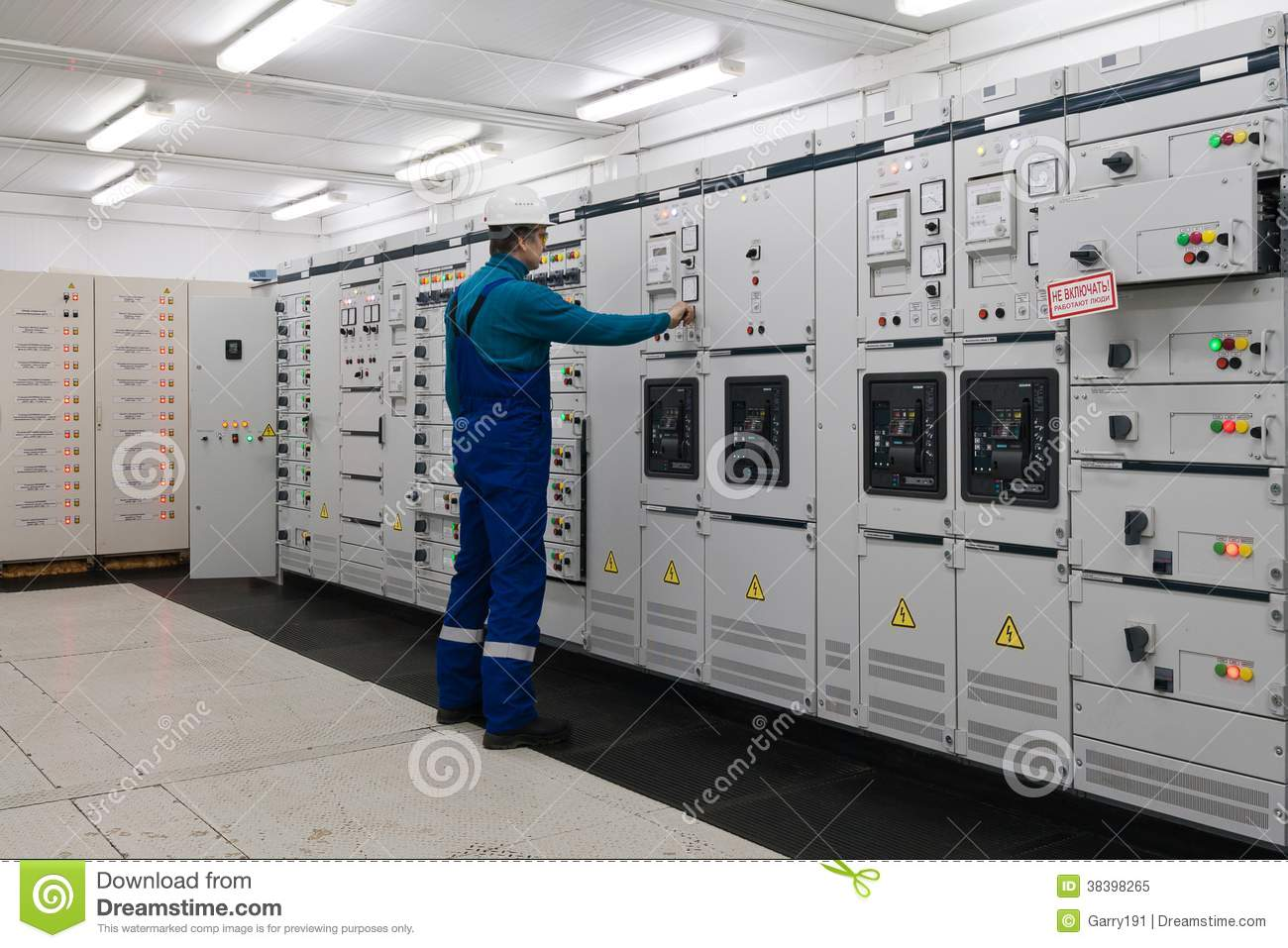 Man is in electrical energy distribution substation for Distribution substation