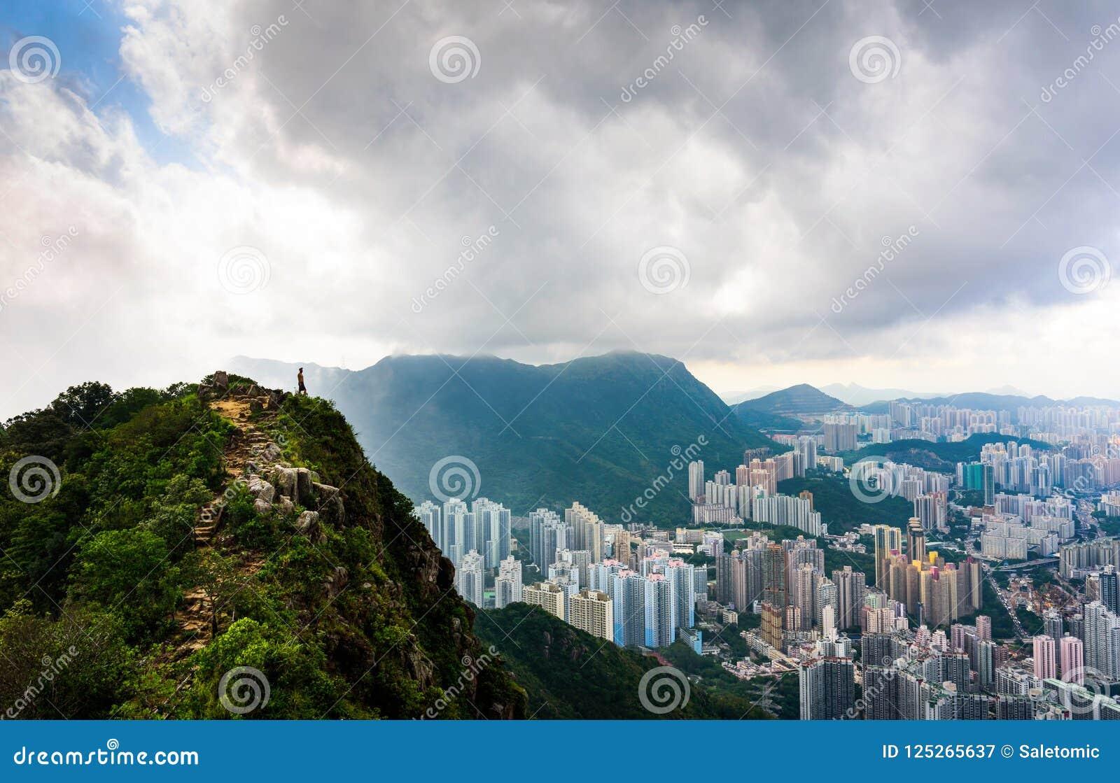 Man enjoying fogy Hong Kong view from the Lion rock