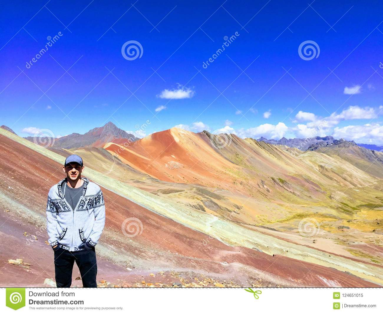 c2c5d2fbc A Man Enjoying The View Of The Incredible Rainbow Mountains Outs ...