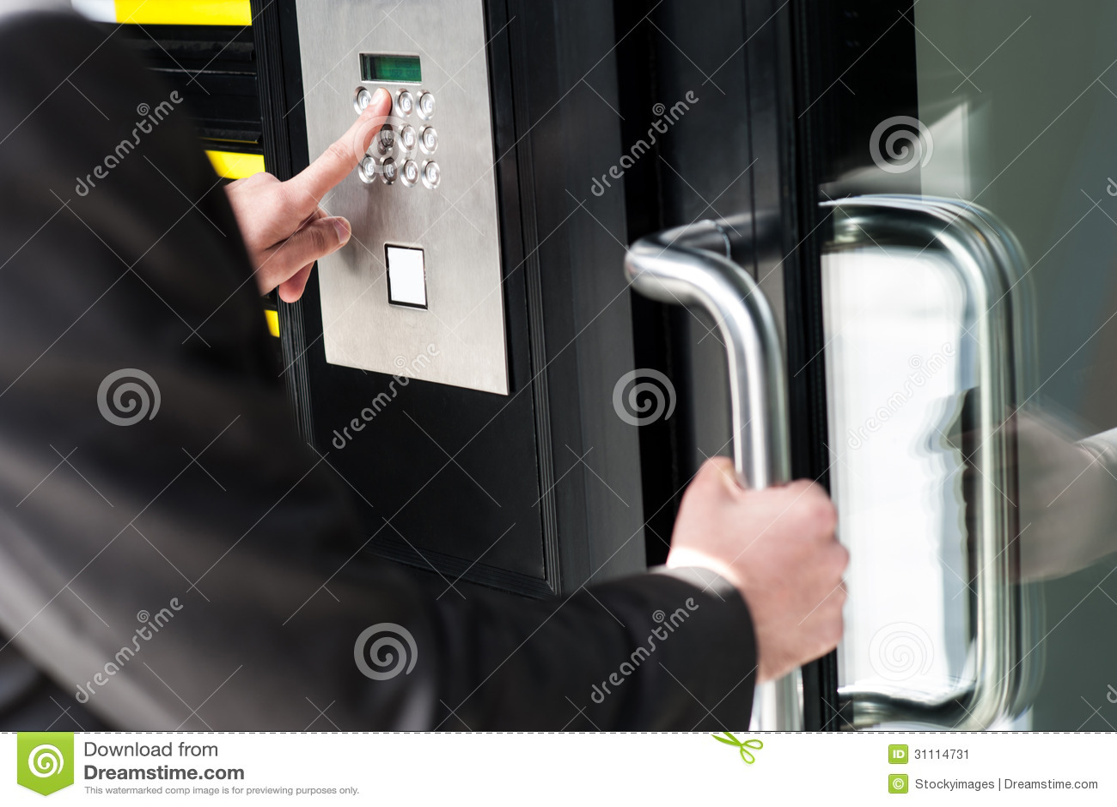 Man entering security code to unlock the door