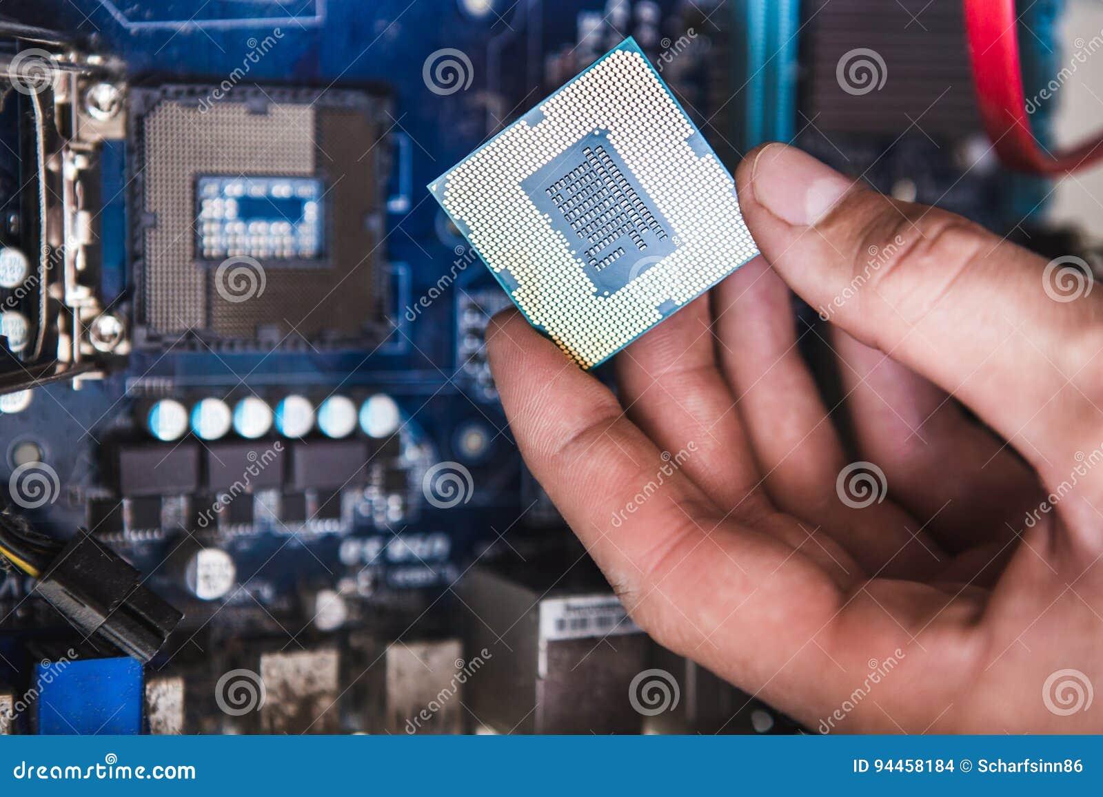 Man Examines Laptop PC Clean Thermal Paste Stock Photo