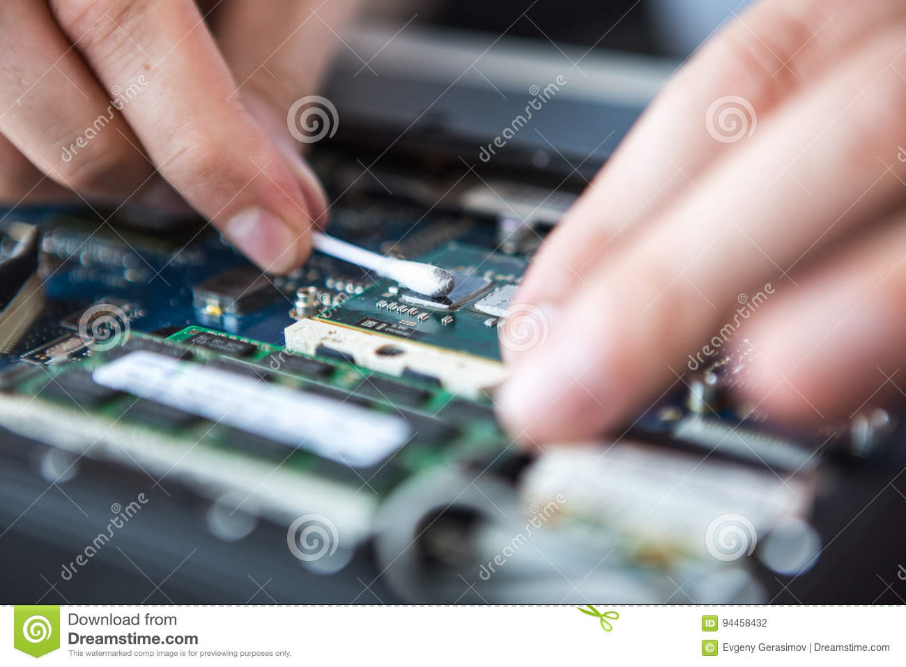 Man Examines Laptop PC Clean Thermal Paste Stock Photo