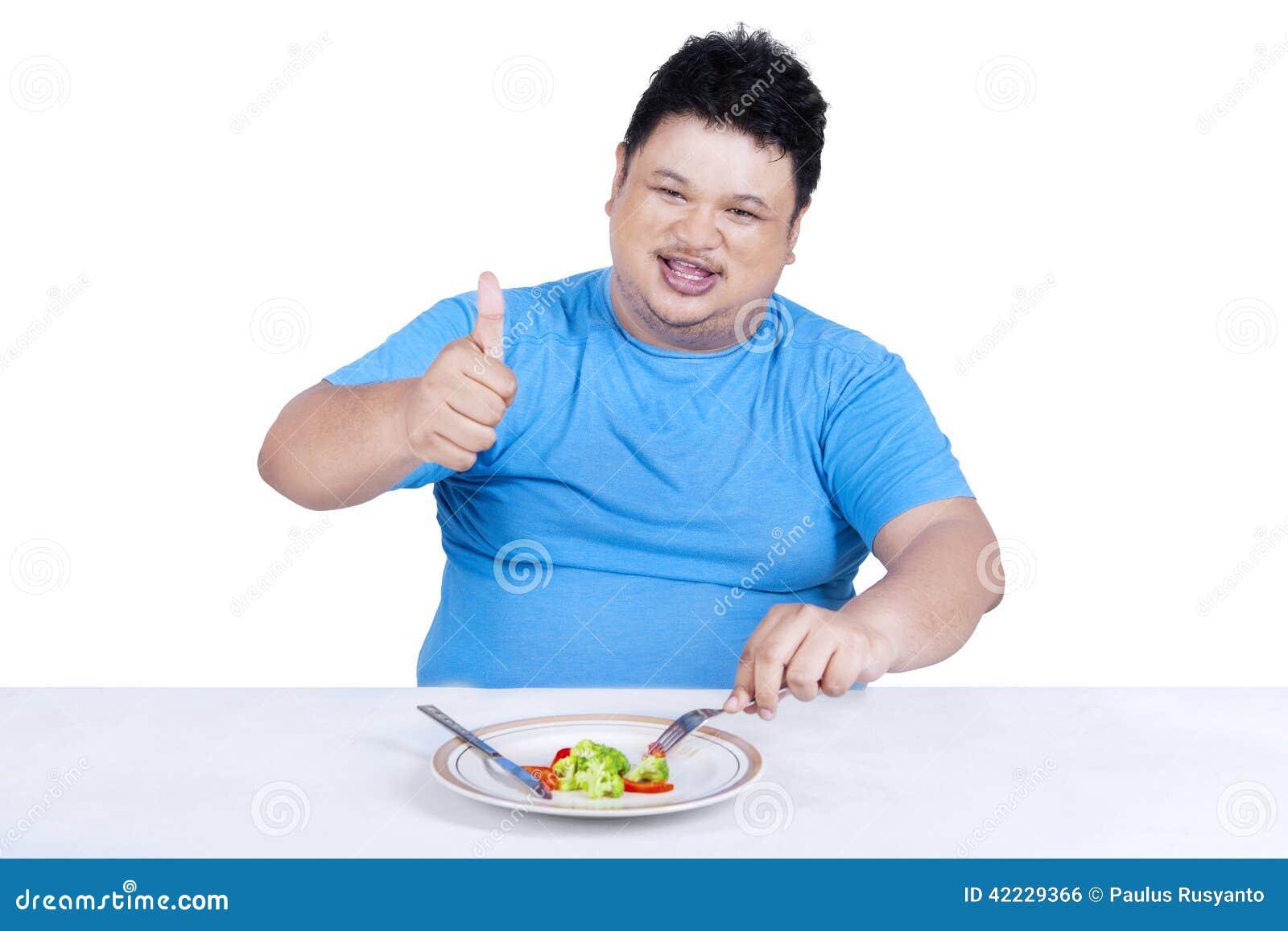 Man försöket att banta, genom att äta sallad 1