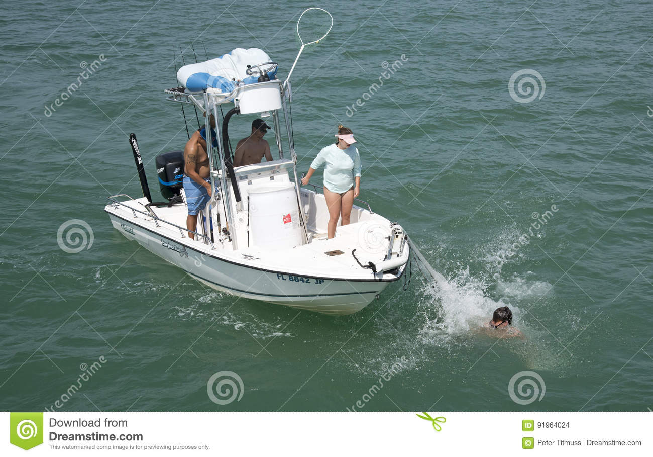 Man Falling Off The Bow Of A Small Fishing Boat Editorial Stock Image - Image: 91964024