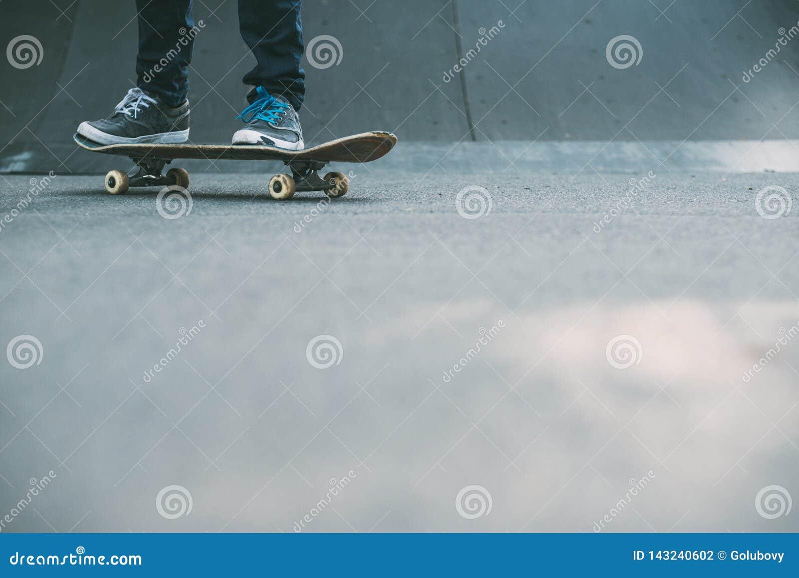 Man feet skateboard ramp urban hipster lifestyle