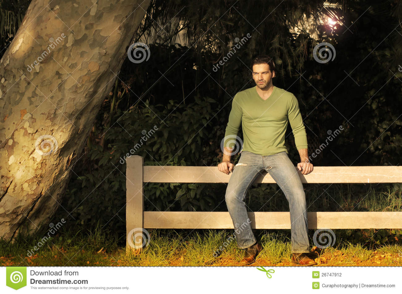 Man On Fence Stock Photography Image 26747912