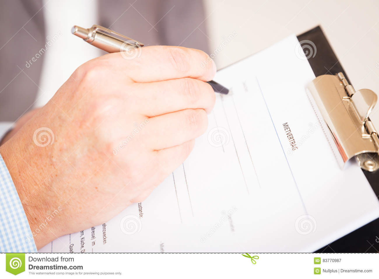 Man Filling Out A German Rental Agreement, Mietvertrag Stock Image ...