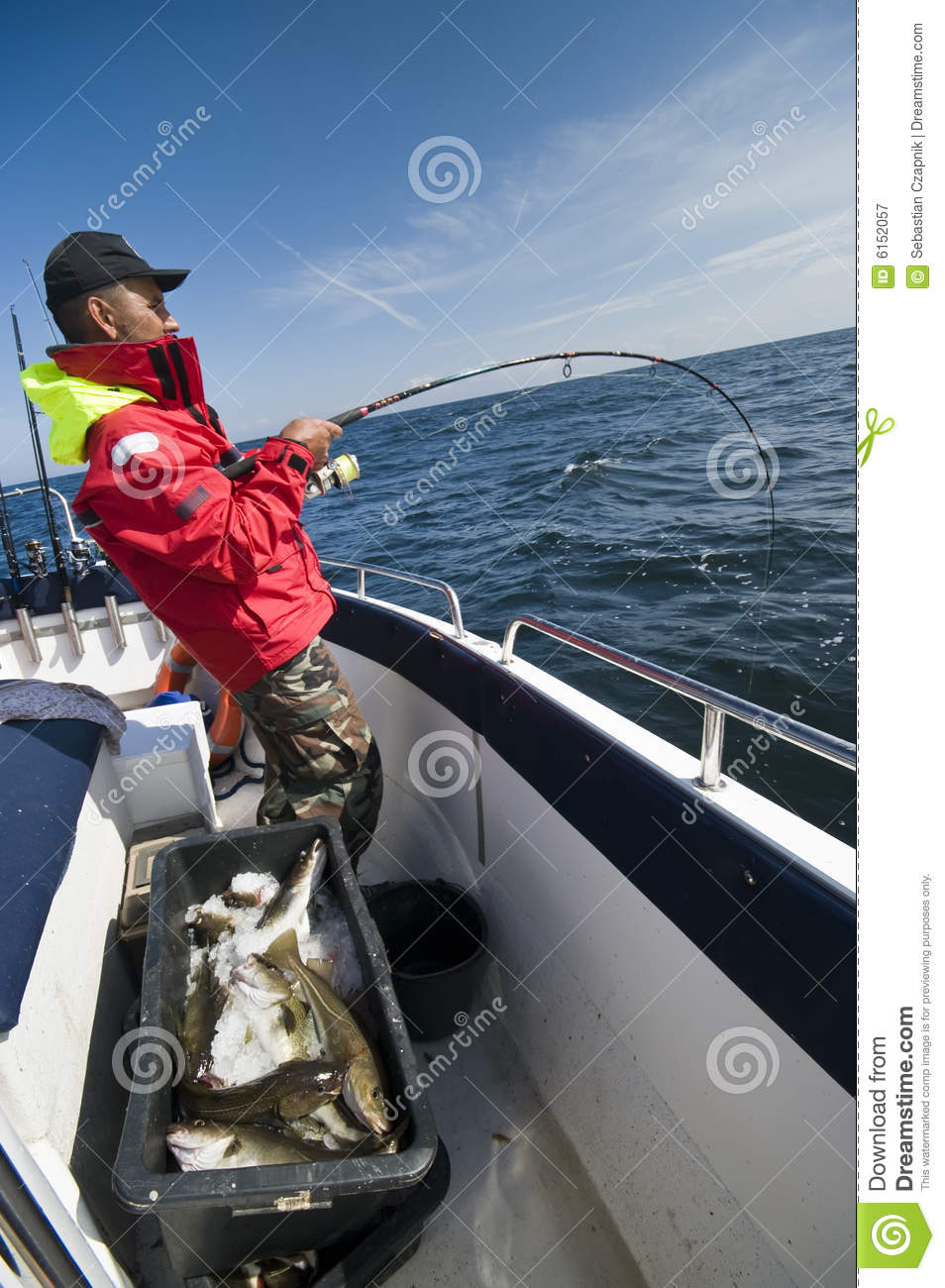 Man fishing for cods at sea