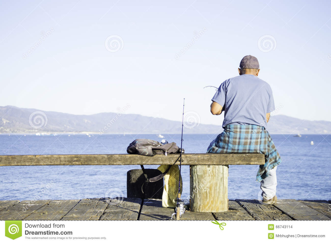 Man fishing on dock stock photo image of active for Fishing off a pier