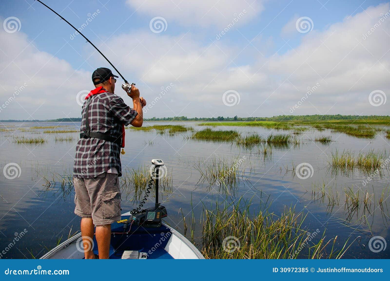 Man fishing fisherman bass royalty free stock photo for Z man fishing