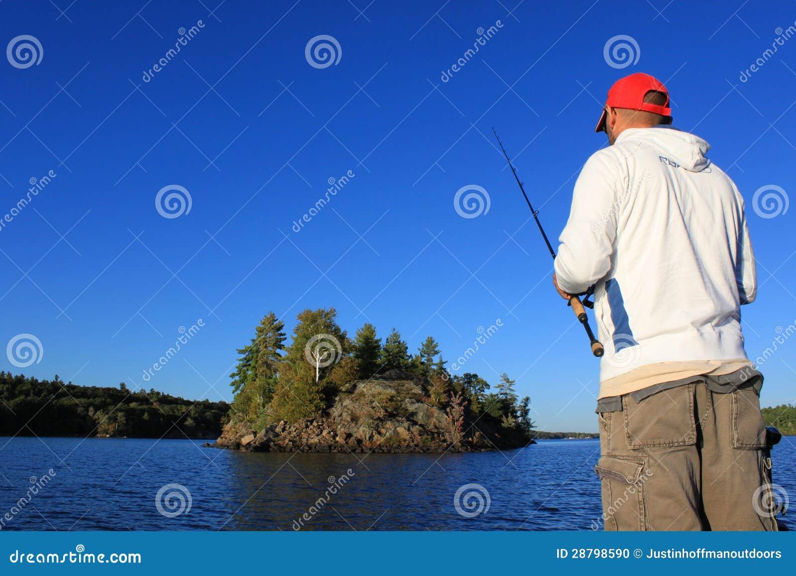 Man fishing on lake stock photo image 28798590 for Z man fishing