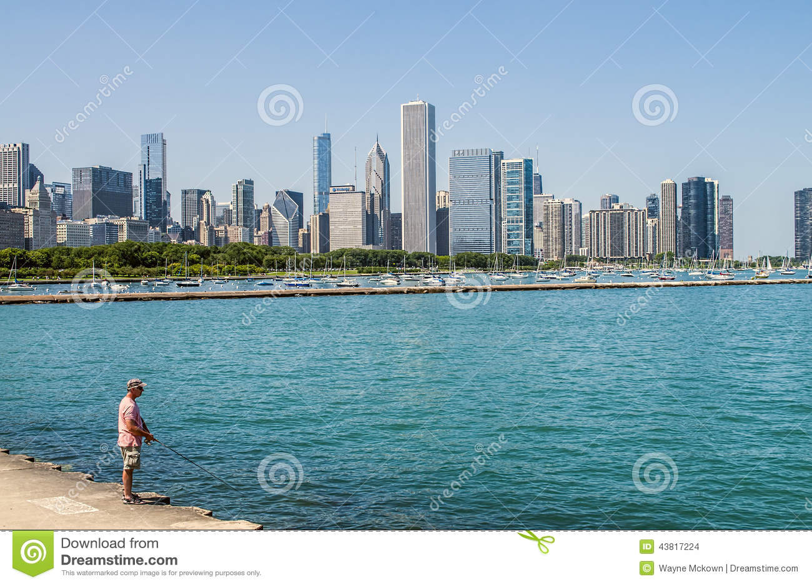 Man fishing on lake michigian editorial stock image for Fishing in chicago