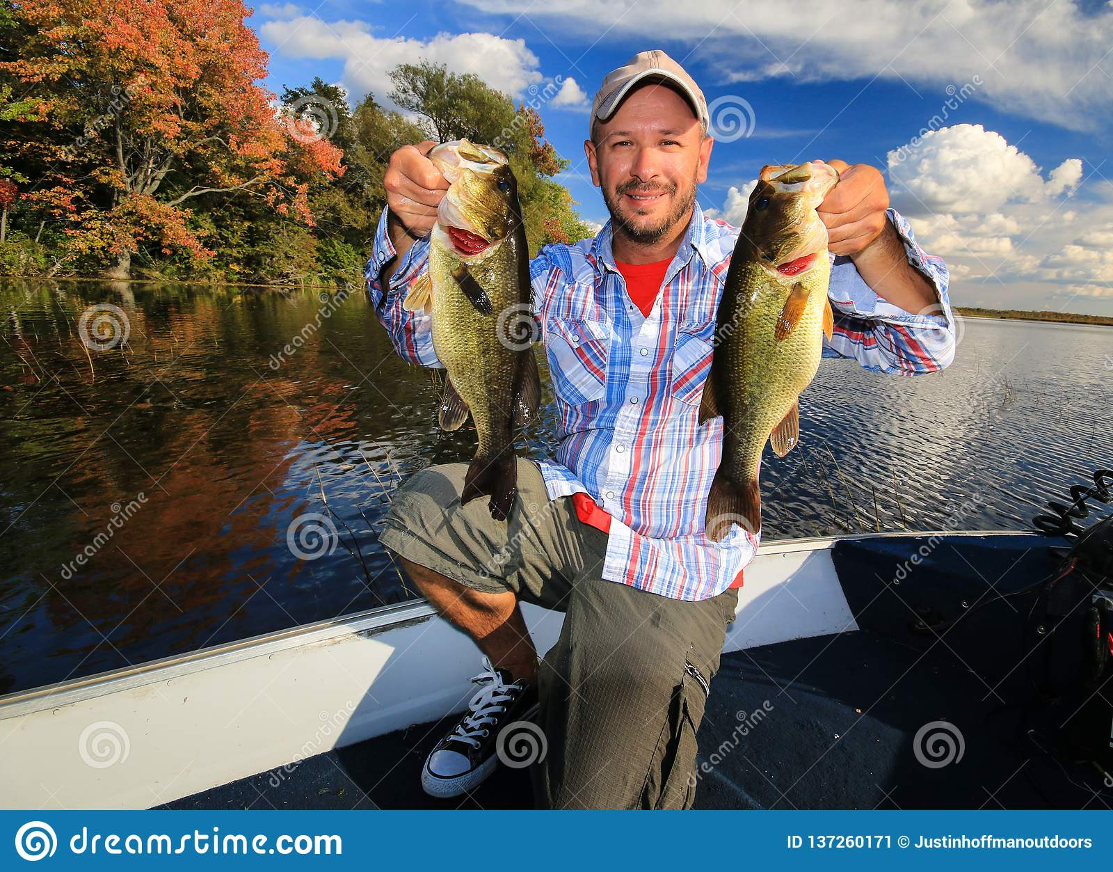 Man Fishing Large Mouth Largemouth Bass in Fall