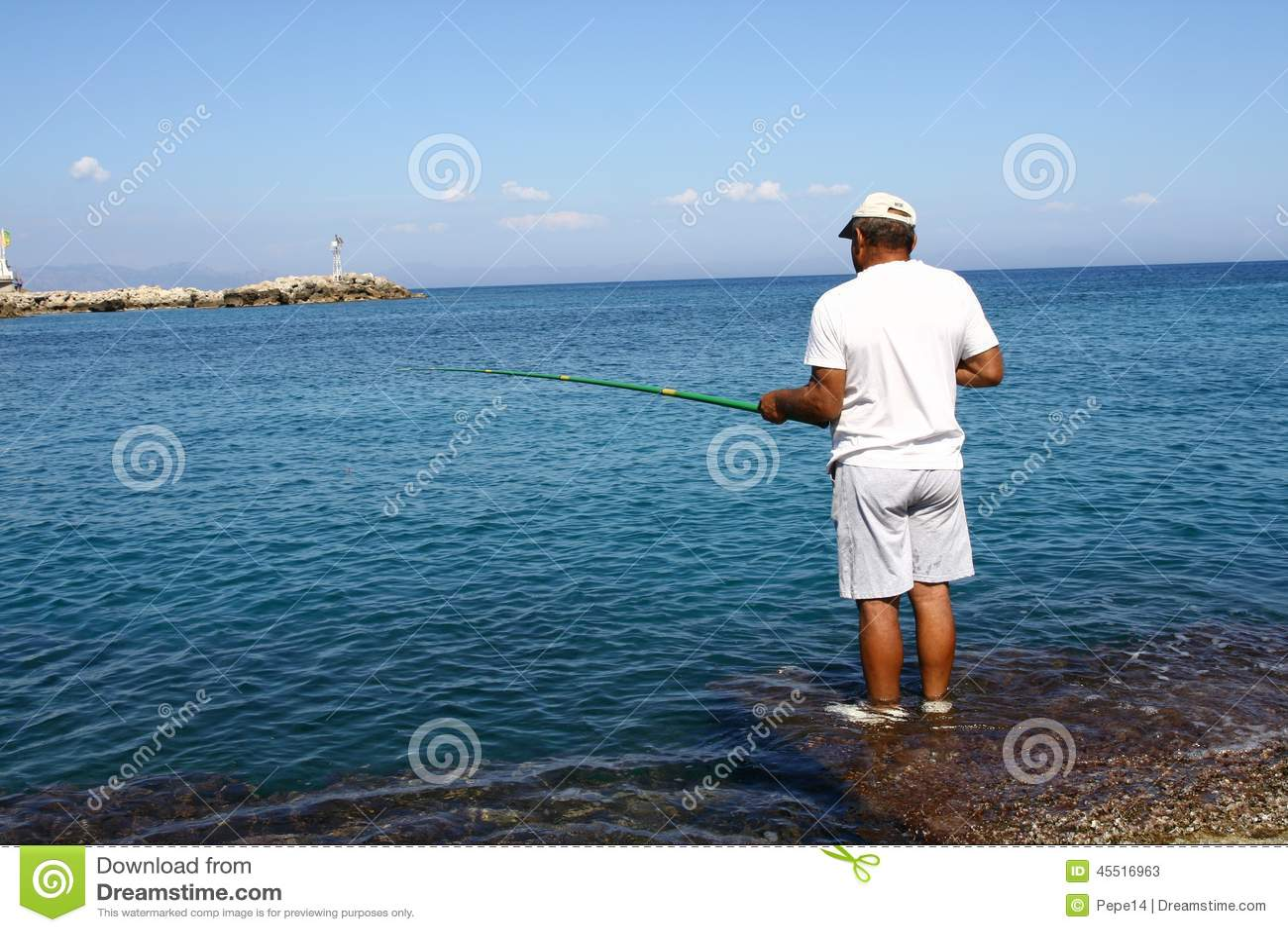 Man fishing in the mandraki port in rhodes editorial stock for Z man fishing