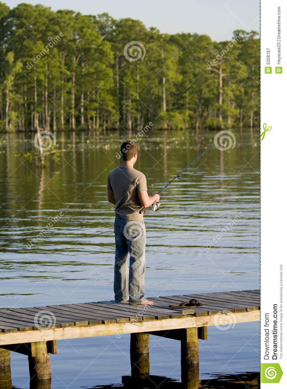 Man fishing off a dock royalty free stock photography for Fishing times free