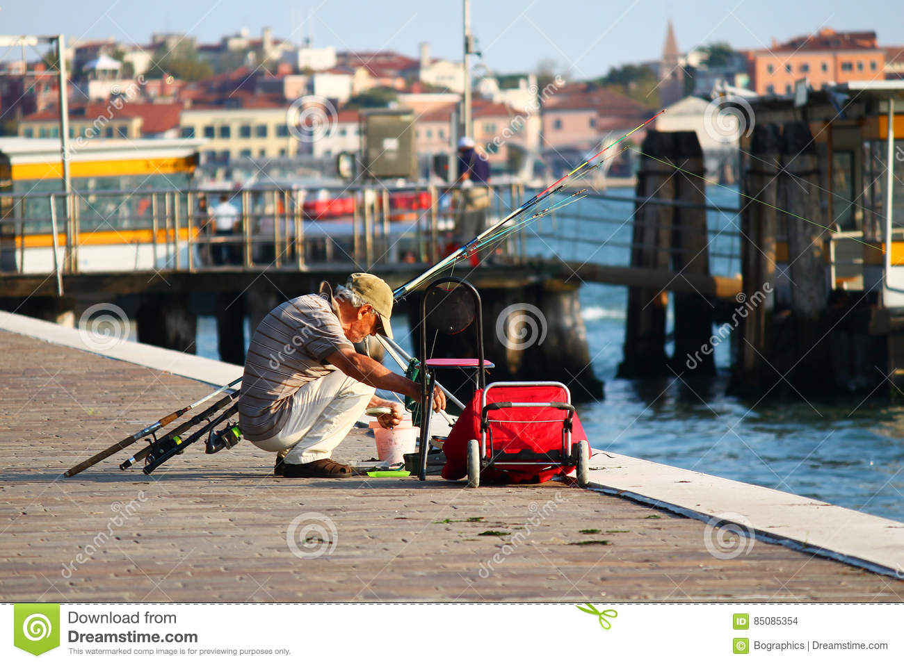 Download Man Fishing From Seafront Near Docks In Venice Editorial Stock Image - Image of fishing, dock: 85085354