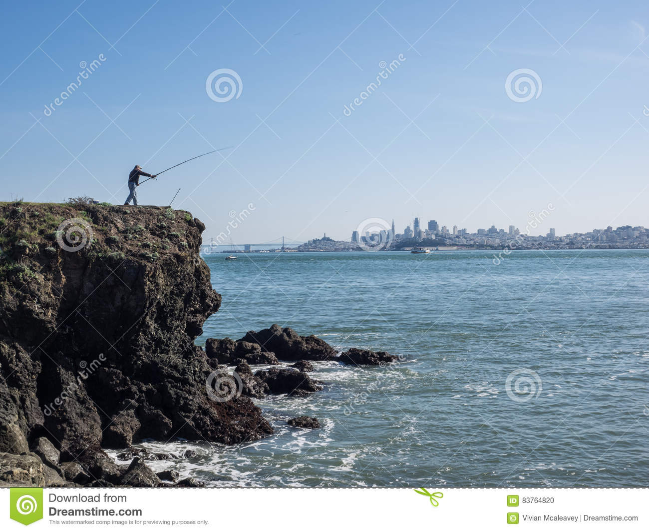 Man fishing with skyline stock photo image 83764820 for Day fishing license ca